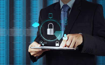 Foto de businessman hand pointing to padlock on touch screen computer as Internet security online business concept  - Imagen libre de derechos