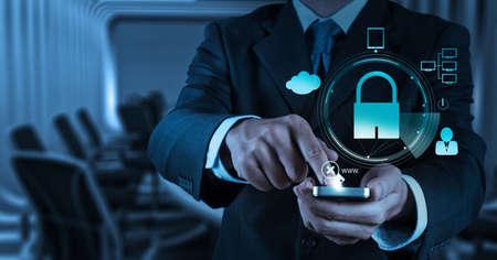 Foto de businessman hand show 3d mobile phone with padlock as Internet security online business concept  - Imagen libre de derechos