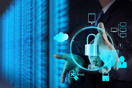Foto de businessman hand showing 3d padlock on touch screen computer as Internet security online business concept  - Imagen libre de derechos