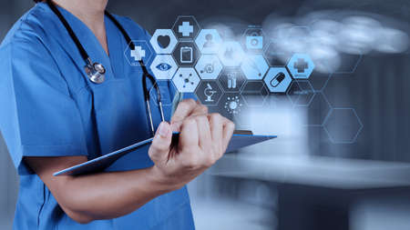 Photo pour Medicine doctor hand working with modern computer interface as medical concept  - image libre de droit