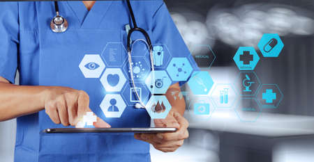 Foto de Medicine doctor hand working with modern computer interface as medical concept  - Imagen libre de derechos