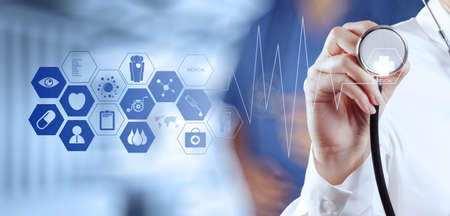 Foto de Medicine doctor hand working with modern computer interface as medical concept - Imagen libre de derechos