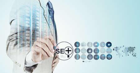 Foto de Double exposure of businessman hand showing search engine optimization SEO as concept - Imagen libre de derechos