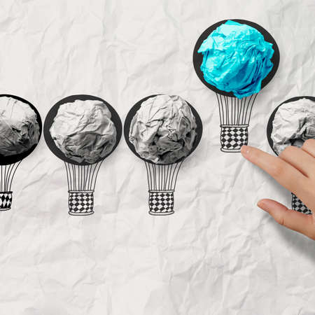 Photo for hand drawn air balloons with crumpled paper ball as leadership concept - Royalty Free Image