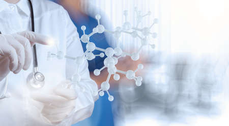 Foto de scientist doctor hand holds virtual molecular structure in the lab as concept - Imagen libre de derechos