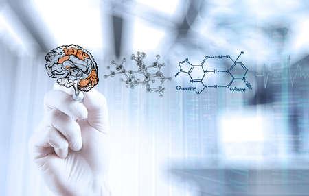 Foto de doctor neurologist hand drawing brain with computer interface as concept - Imagen libre de derechos
