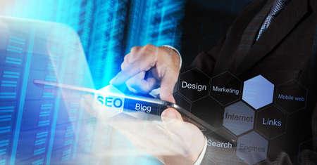 Foto de businessman hand showing search engine optimization SEO as concept - Imagen libre de derechos