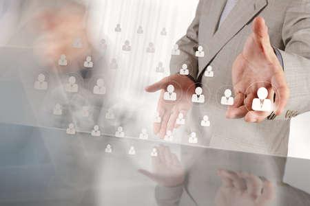 Photo pour businessman hand choosing people icon as human resources concept - image libre de droit