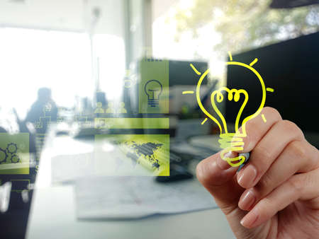 Foto de hand drawing creative business strategy with light bulb as concept - Imagen libre de derechos