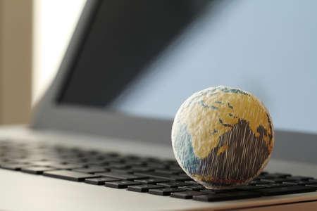 Photo pour hand drawn texture globe on laptop computer as internet concept - image libre de droit