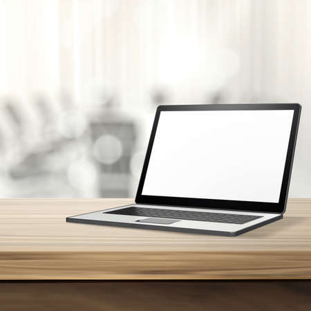 Photo pour Laptop with blank screen on wood table and blurred background - image libre de droit