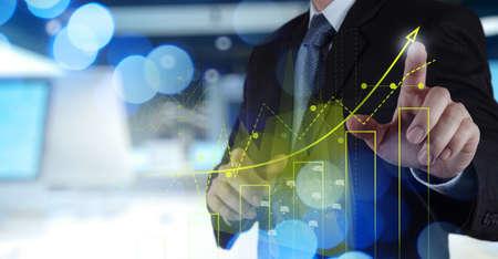 Foto de Double exposure of businessman hand working with new modern computer and business strategy as concept - Imagen libre de derechos