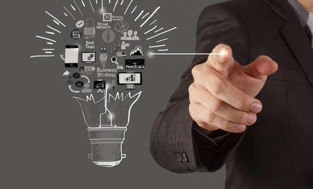 Foto de hand drawing creative business strategy with light bulb as concept - Imagen libre de derechos