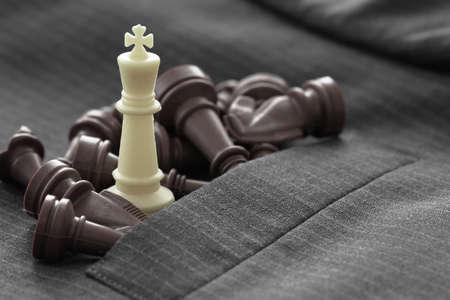 Foto de close up of chess figure on suit background strategy or leadership concept - Imagen libre de derechos