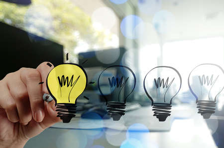 Photo for businessman hand drawing creative business strategy with light bulb as concept - Royalty Free Image