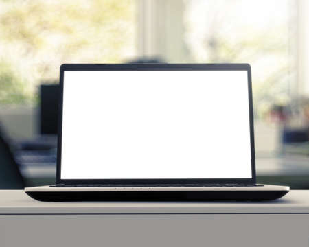 Photo pour Laptop with blank screen on white desk with blurred background as concept - image libre de droit