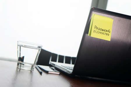 Foto de easy password on sticky note on back Laptop in office room as concept - Imagen libre de derechos
