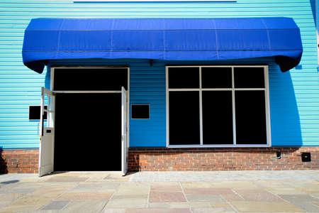 Foto de Shopfront vintage store front with canvas awnings and blank display - Imagen libre de derechos
