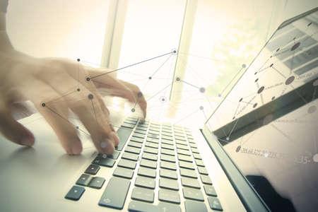Foto de businessman hand working with business documents on office table with laptop computer with social media diagram - Imagen libre de derechos