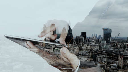 Photo pour Double exposure of businessman working with new modern computer and london city background as concept - image libre de droit