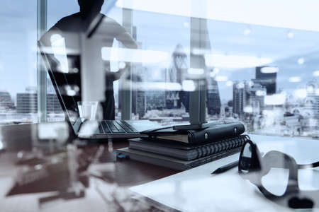 Photo pour double exposure of business documents on office table with smart phone and digital tablet and london city blurred view and man thinking in the background - image libre de droit