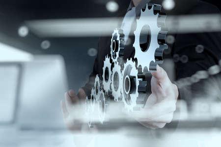 Foto de double exposure of businessman hand show human gear to success as concept - Imagen libre de derechos