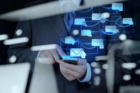 Foto de double exposure of businessman hand use smart phone computer with email icon as concept - Imagen libre de derechos