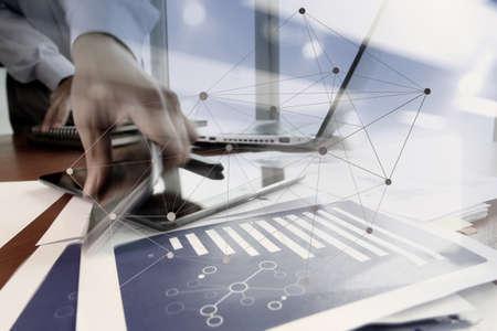 Foto de double exposure of Businessman hand using mobile phone with social network diagram on wooden desk as concept - Imagen libre de derechos