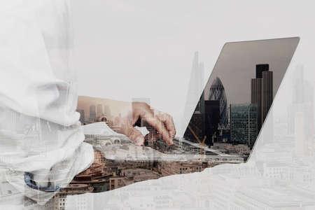 Photo pour Double exposure of success businessman using laptop computer with london building and social media diagram - image libre de droit