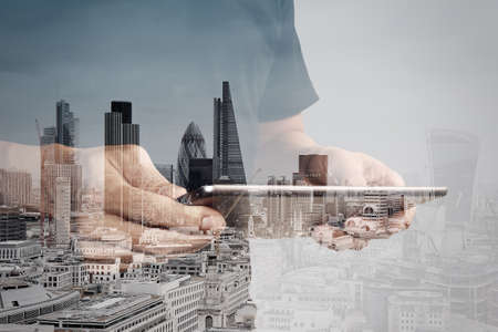 Foto für Double exposure of success businessman using digital tablet with london building and social media diagram - Lizenzfreies Bild