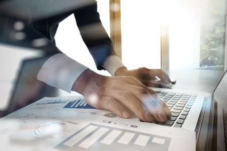 Foto de Double exposure of business man hand working on blank screen laptop computer on wooden desk as concept - Imagen libre de derechos