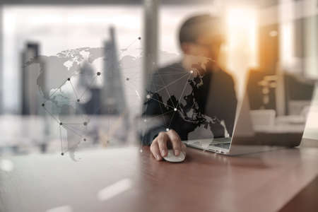Foto de Young creative designer man working at office with computer laptop as concept with social media diagram - Imagen libre de derechos