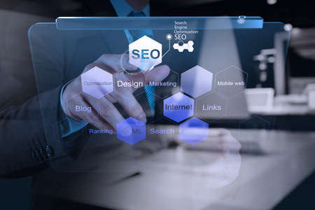 Photo pour double exposure of businessman hand showing search engine optimization SEO as concept - image libre de droit