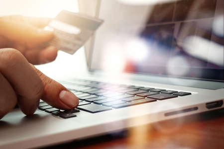 Photo for close up of hands using laptop and holding credit card  as Online shopping concept - Royalty Free Image