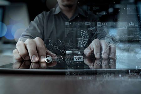 Foto de businessman hand working with modern technology digital tablet computer and digital layer effect as business strategy concept - Imagen libre de derechos