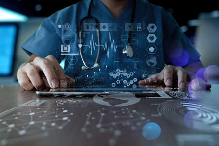 Foto de Medicine doctor hand working with modern computer interface as medical network concept - Imagen libre de derechos