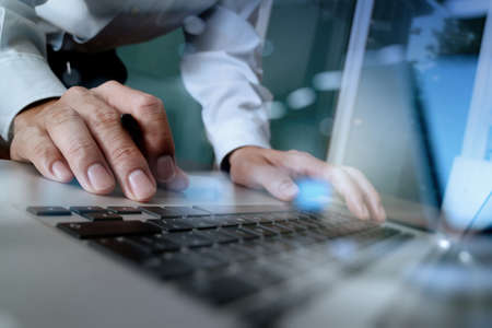 Photo pour Close up of business man hand working on blank screen laptop computer on wooden desk as concept - image libre de droit
