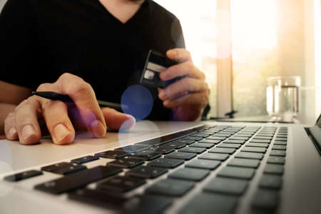 Photo pour hands using laptop and holding credit card with social media diagram as Online shopping concept - image libre de droit