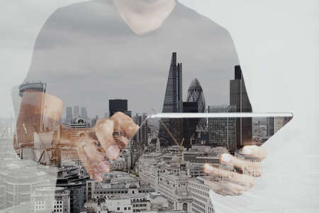 Foto de Double exposure of success businessman using digital tablet with london building and social media diagram - Imagen libre de derechos