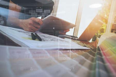 Foto de Designer hand working with laptop computer and smarth phone and digital tablet with digital design diagram layer on wooden desk as responsive web design concept - Imagen libre de derechos