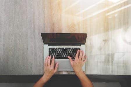 Foto de top view of Designer hand working with laptop computer on wooden desk as responsive web design concept - Imagen libre de derechos