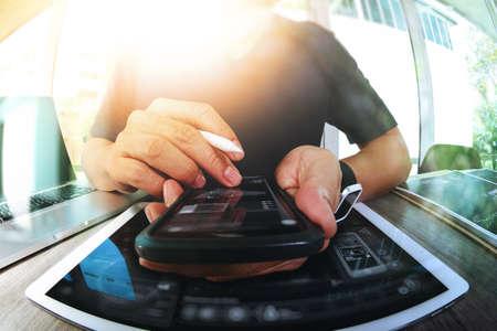 Foto de Website designer working digital tablet and smart phone and digital design diagram on wooden desk as concept - Imagen libre de derechos