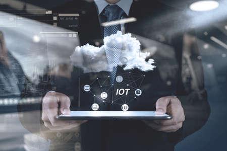 Foto de double exposure of hand showing Internet of things (IoT) word diagram as concept - Imagen libre de derechos
