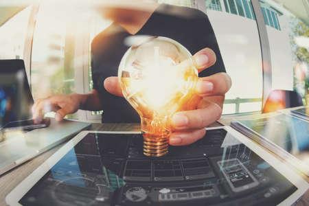 Photo pour designer hand showing creative business strategy with light bulb as concept - image libre de droit