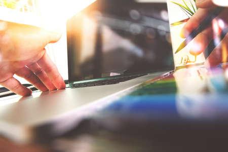 Foto de close up of Designer hand working with laptop computer on wooden desk as responsive web design concept - Imagen libre de derechos
