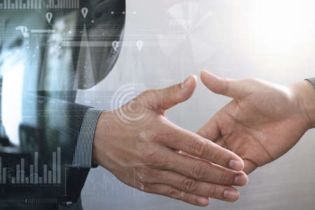 Business partnership meeting concept.photo businessmans handshake. Successful businessmen handshaking after perfect deal.close up,virtual graph chart interface screen