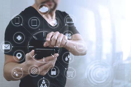 Foto de Businessman hand using smart phone for mobile payments online shopping,omni channel,virtual computer interface - Imagen libre de derechos