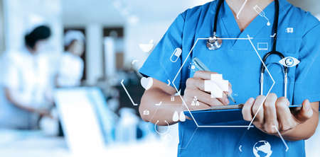 Photo for Smart medical doctor writing nformation patient medical on a clipboard at the hospital with VR icon diagram - Royalty Free Image