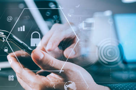 Foto de cyber security internet and networking concept.Businessman hand working with VR screen padlock icon mobile phone on computer background - Imagen libre de derechos
