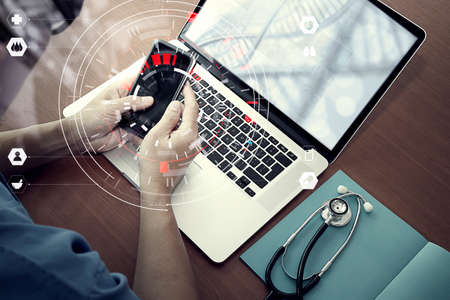 Photo pour Medical technology concept,smart doctor hand working with modern computer in hospital office with virtual icon diagram - image libre de droit